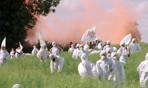 Protesters destroying GM crop research  (image: http://www.theguardian.com/)